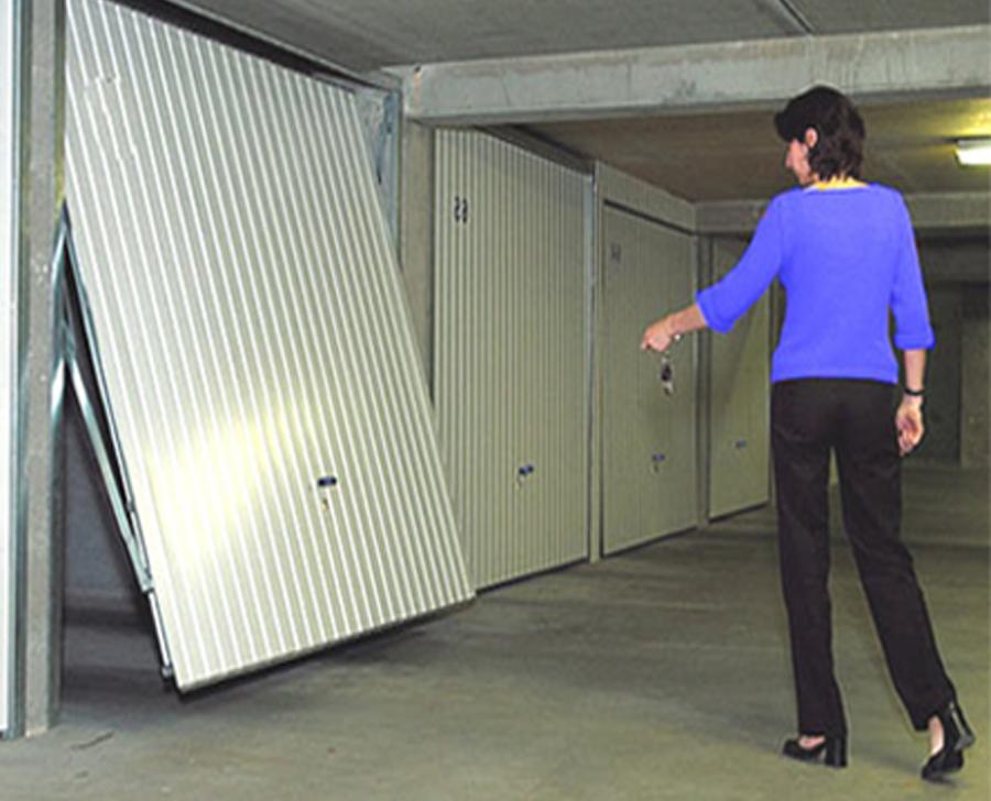Installation reparation porte de garage manuelle ou for Reparation porte garage